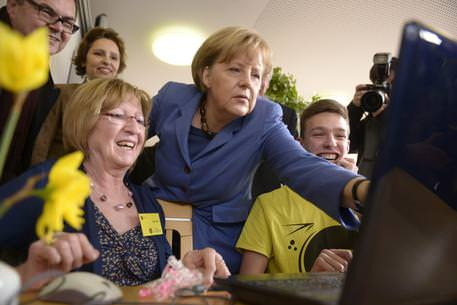 Merkel visits multigenerational housing project